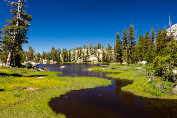 A winding stream flows into Jewelry Lake, Emigrant Wilderness, CA.
